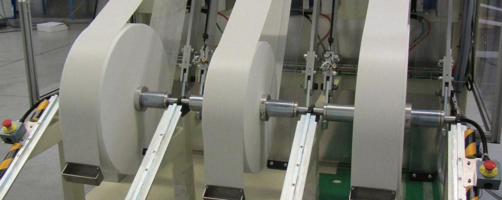 Déroulage de produits en multi bobines - Simultaneous unwinding up to 6 rolls.